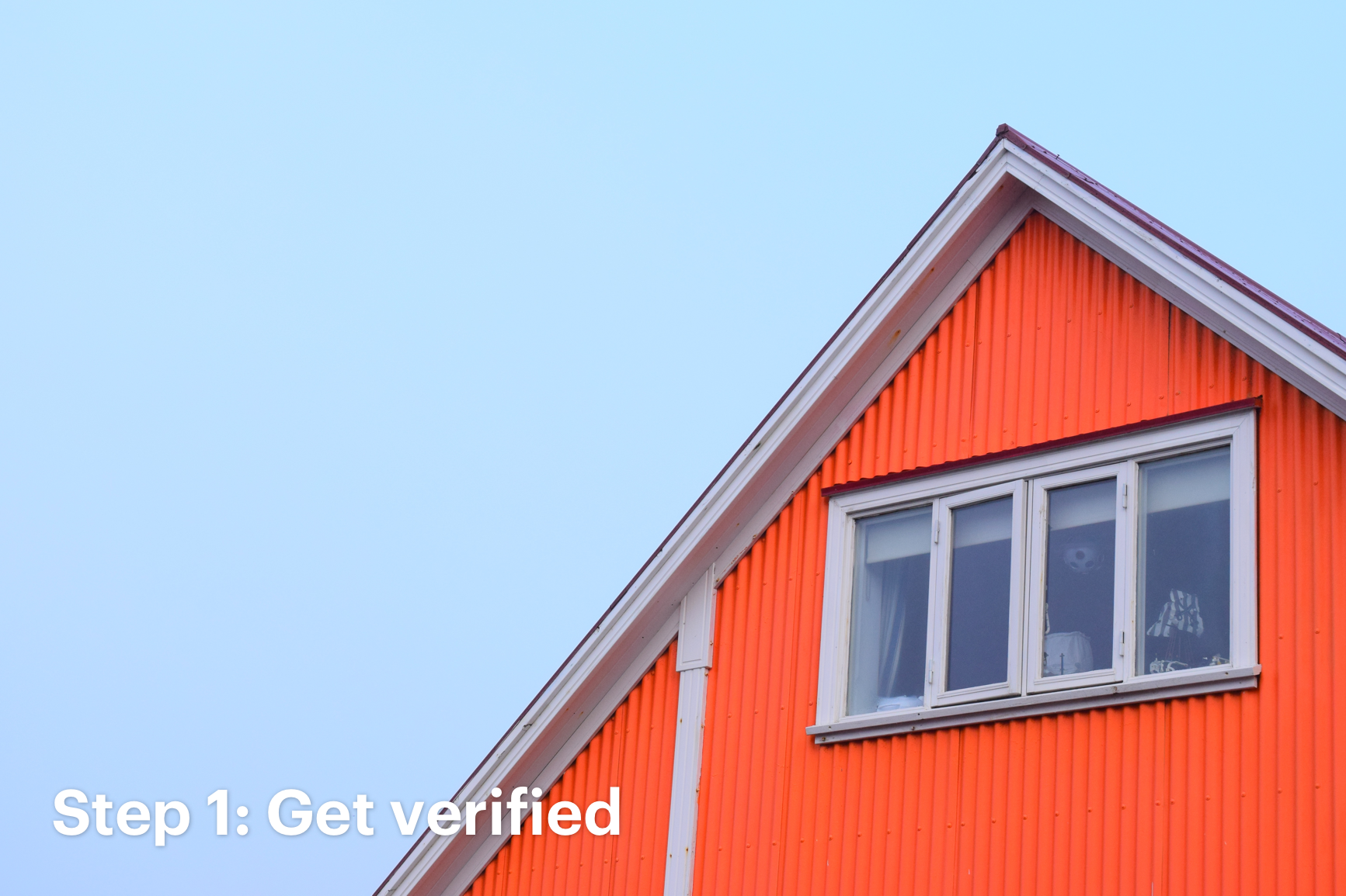 Close Up of Red Home Against Light Blue Sky with Text That Reads: Step 1: Get Verified