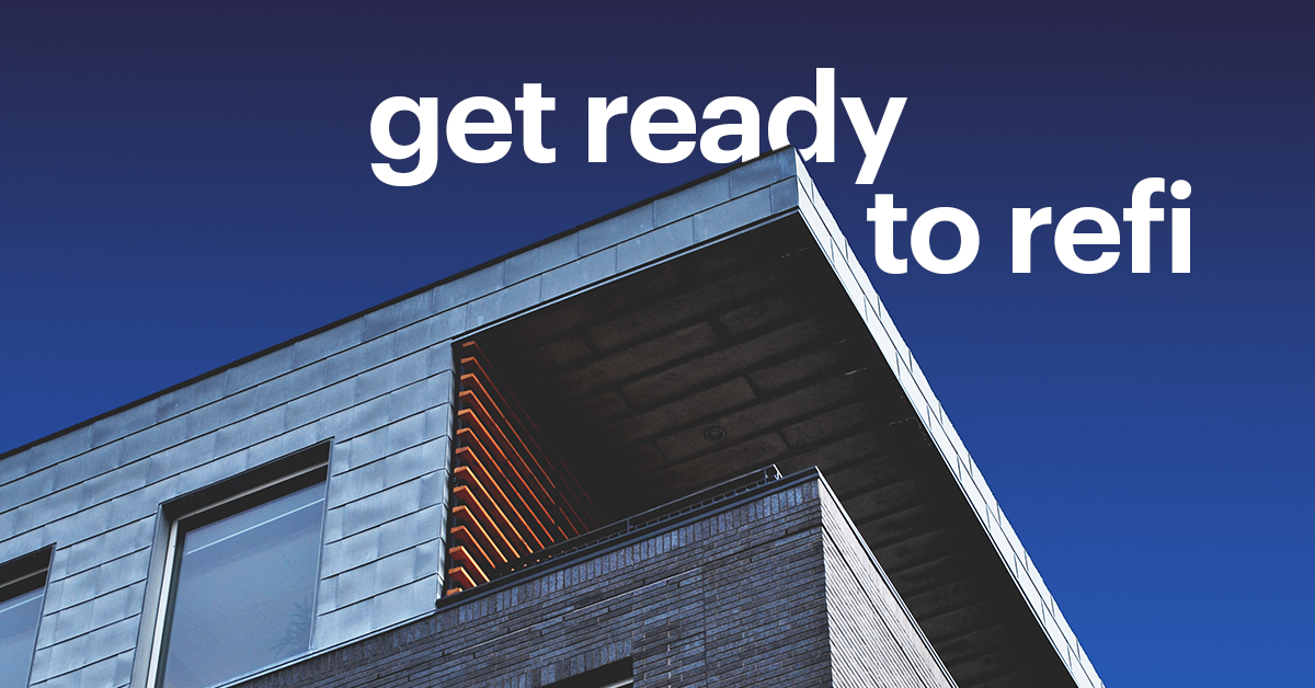 """Top Right Corner of Modern Grey Building Against Blue Sky and """"Get Ready to Refi"""""""