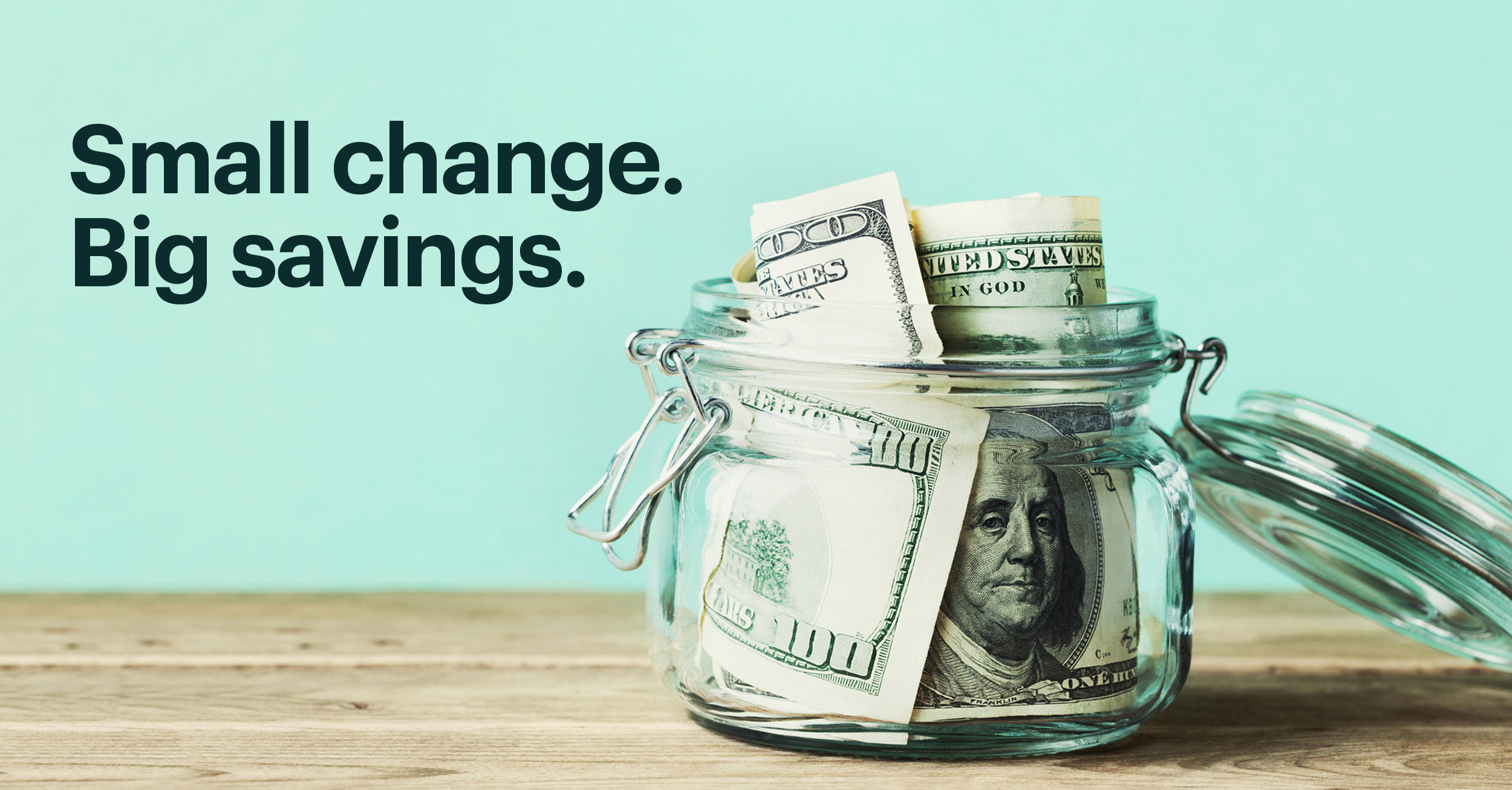 Jar of Money on a Wooden Table with Text That Reads: Small Change. Big Savings