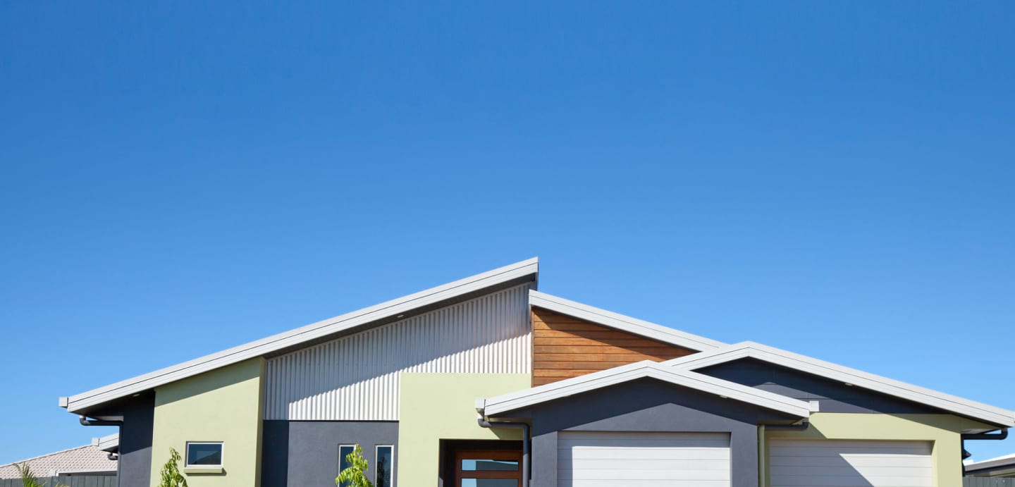 Curbside view of modern home and with blue skies