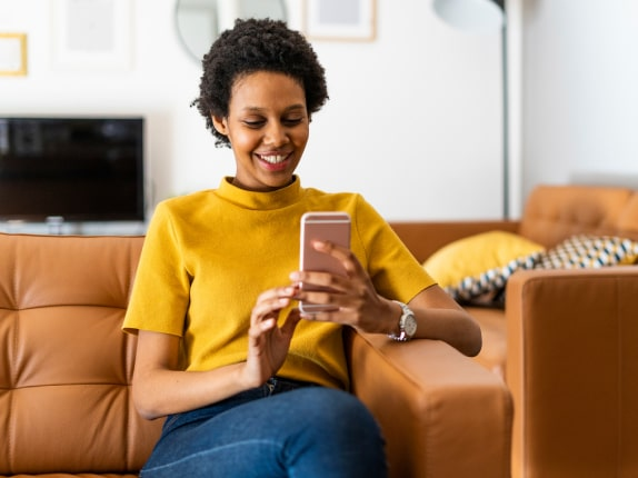 Person on couch using their phone