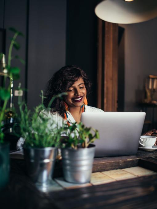 Smiling lady using laptop