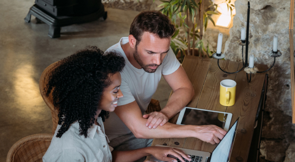 Potential borrowers applying online at a coffee shop